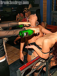 Lesbian babes inserting with a beer bottle in friends pussy