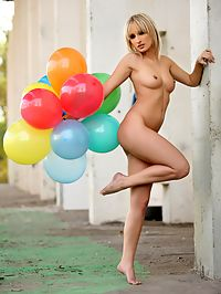 Very beautiful sexy babe holding several balloons pictures