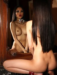Cute and very sexy asian babe wearing a muzzle in the nude