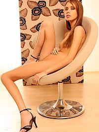Fit long legged brunette teen babe showing her fine body