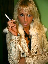 Smoking blonde babe showing her sensual erotic body parts