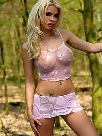 Big breasted blonde glamour model is nude in the nature