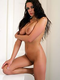 Busty brunette sweetheart showing her big naked boobies