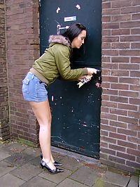 Brunette girl loves cock trough holes in a public toilet