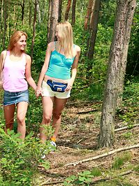 Blonde and redhead naughty lesbian teens playing outdoors
