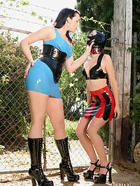 Kinky massaging her very damp latex wearing slave pussy