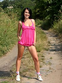 Brunette teen girl masturbating on a road with a pink toy