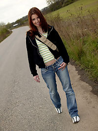 Hot little redhaired teen masturbating outside in the woods