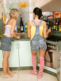 Horny teenagers in their kitchen massaging damp pussies