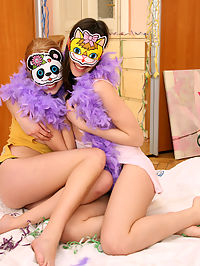 Horny girls wearing masks licking each others wet pussy