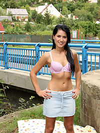 Teenage cutie publicly masturbating near a bridge outdoors
