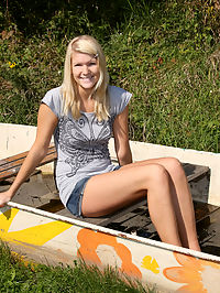 A teenage blonde in a stranded boat masturbates with a toy