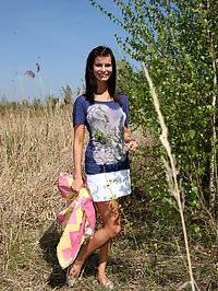A cutie pleasuring herself outside in the bushes with a toy