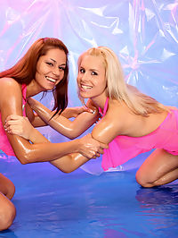 Two oiled up lesbians are pleasuring eachothers wet clit