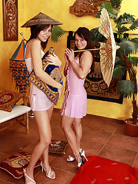 Two cute brunette teens playing oriental dildo sex games