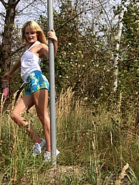Hot blonde teen performs as sexy poledancer in the park