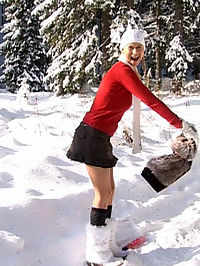 Teenage cutie with pigtails toying her pussy in the snow