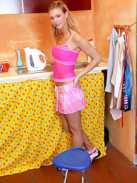 Cute teen posing and playing with her pink dildo in kitchen