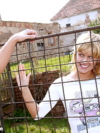 Blonde teenie girl receives a facial in her own backyard