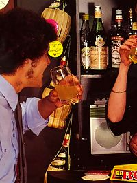Two seventies couples getting dirty together inside a bar
