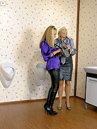 Hot blonde lesbian babes getting sprayed with fake jizz