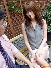 Japanese teenage girl giving a rough but sloppy blowjob