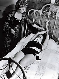 Vintage naked chicks are slapped hard and tied to a bed