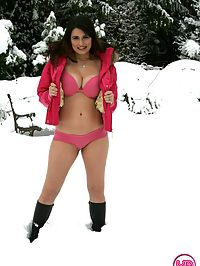Busty hottie playing in the snow with a sex toy outdoors