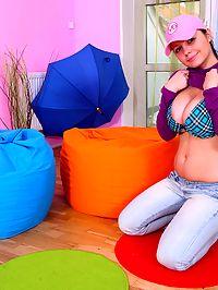 Teen pleasuring her muff with a big plastic dildo alone
