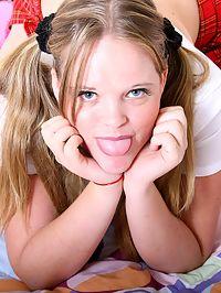 Blonde schoolgirl showing her huge fine natural titties
