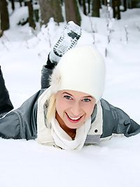 Big breasted blonde teenager toying her pussy in the snow