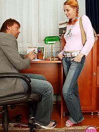 Busty redhead teenie girl handles a stiffy office penis