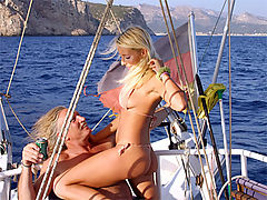 Blonde beauty enjoys two senior erections on their yacht