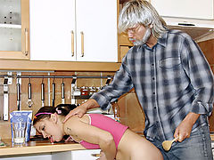Teenager gets fucked in the kitchen by a horny senior guy