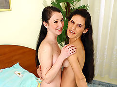Two dirty brunette teenage girls sharing a stiffy erection