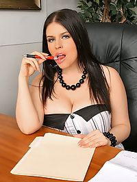 Daphne is showing her assistant whos boss here as she fucks the shit out of him on the top of her desk in these hot big tittied boss pics