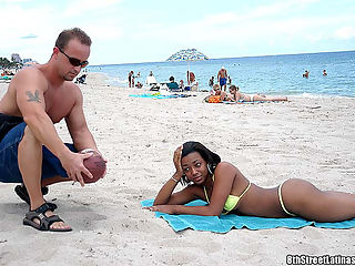 Bikini wearing ebony latina gets on her knees to suck