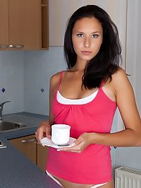 July Saint strips butt naked over her morning coffee.