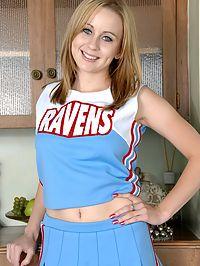 Spunky Cheerleader Mae Lynn exposes her pussy.