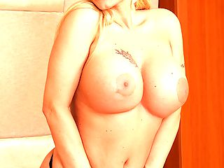 Busty Kelly Lenox jams mature pussy with pink toy.