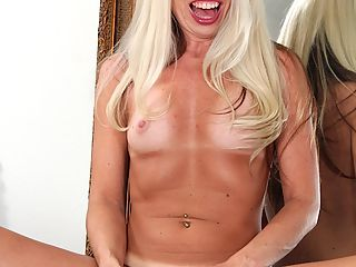 Tan lined mature amateur Meredith masturbates with her toy.