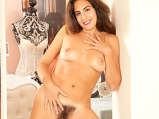 Mature Latina Liz plays with her natural hairy pussy.