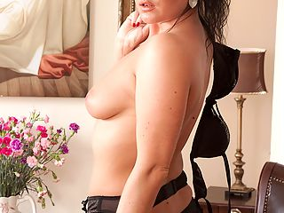 Sexy business woman Danielle strips down to only black stockings.