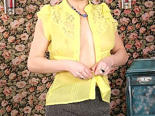 Elegant older babe Natalie strips and rubs her pussy.