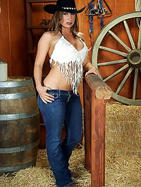 Devon Lee topless cowgirl : Busty Devon Lee is a topless cowgirl ready to ride