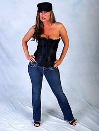 Busty MILF babe Devon Lee : Hot busty MILF Devon Lee poses in corset and jeans