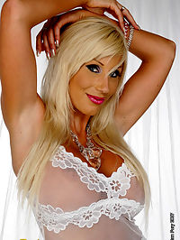 Puma Swede poses on white : Blonde Puma Swede poses and plays with glass dildo