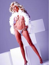 Puma Swede enjoys a dildo : Puma Swede in white feathers using neon pink dildo