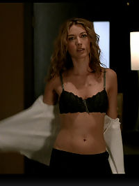 Natalie Zea looks amazing in black and white seductive lingerie