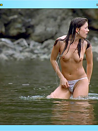 Erica Durance exposes her hot knockers and white thong in the water